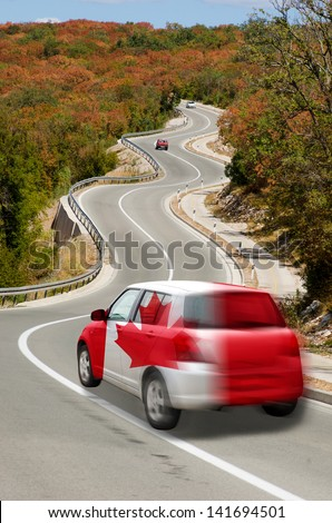 traveling car in national flag of canada colors and beautiful road landscape for tourism and touristic adertising