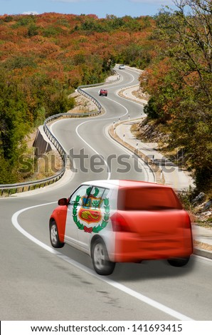 traveling car in national flag of peru colors and beautiful road landscape for tourism and touristic adertising