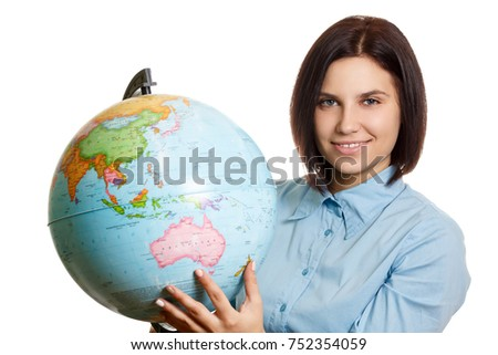 Traveling concept, beautiful woman with globe ball isolated on white background