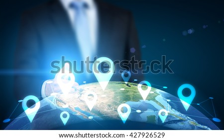Traveling concept with businessman pointing at globe with location pin network on dark background. Elements of this image furnished by NASA - stock photo