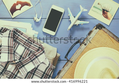 traveling concept with clothes ready to be packed. vintage filtered and toned. top view  - stock photo