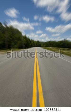Traveling Down the Road in Fast Motion - stock photo
