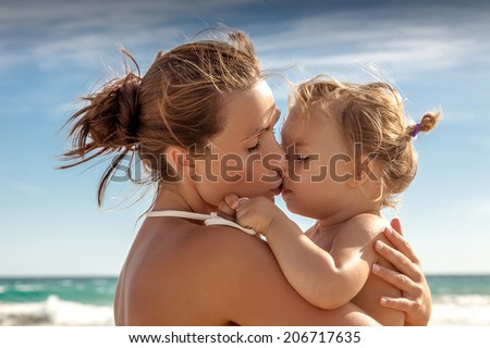 traveling family  female woman hugs baby on vacations - stock photo
