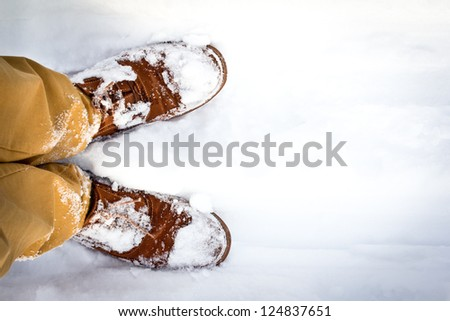 Traveling on the first winter snow. Unusual view - from my eyes. - stock photo