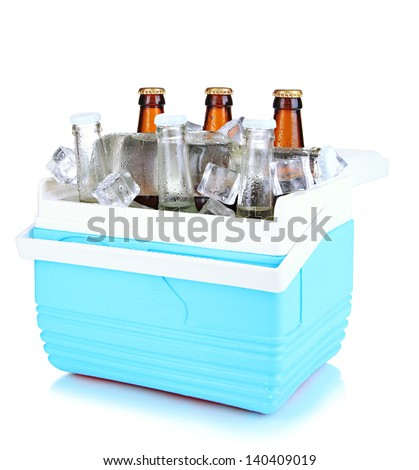 Traveling refrigerator with beer bottles and ice cubes isolated on white - stock photo