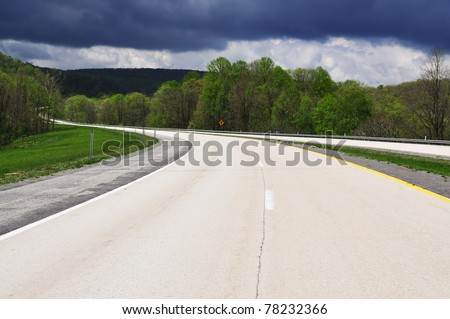 Traveling Route 33, Corridor H Freeway approaching storm, West Virginia, USA