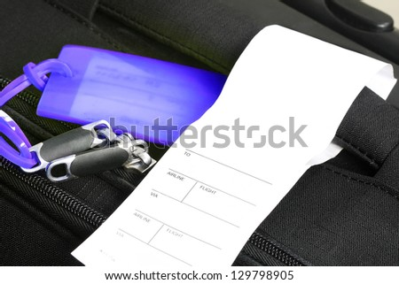 Traveling suitcase with checkin label (manual focus) - stock photo