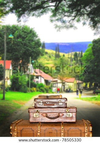 Traveling suitcases in the street in the small town of Pilgrims Rest in South Africa - stock photo