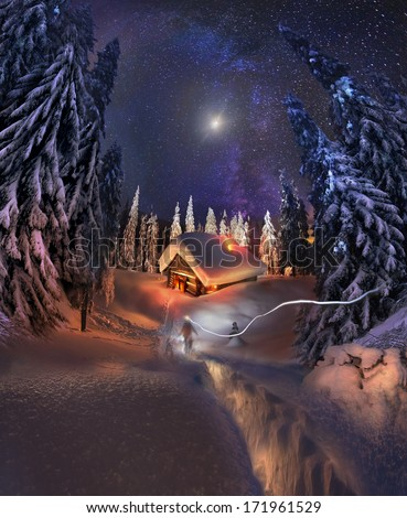 Traveling through the winter mountains, bold and romantic people can find shelter in the hunting huts, Glued to the panorama at a slow. The Milky Way galaxy , as smoke rises over the frozen nature...
