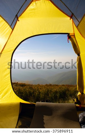 Traveling. Tourism. Tourist tent camping in mount - stock photo