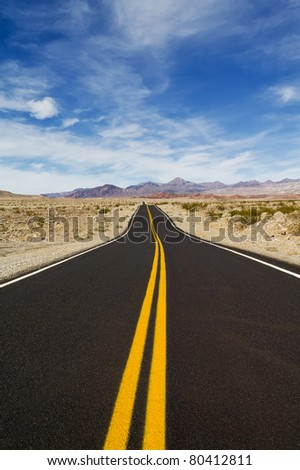 Travelings down the road in desert - stock photo