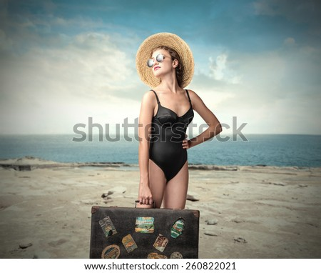 Traveller at the beach  - stock photo