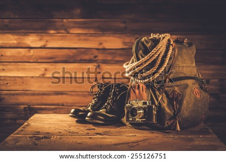 Traveller concept in a wooden interior  - stock photo
