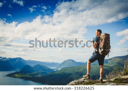 Traveller with backpack and mountain panorama  - stock photo