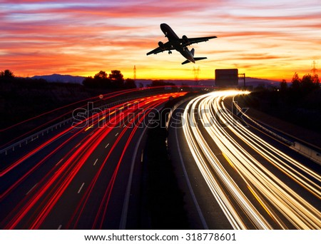 Travelling by plane or by road - stock photo
