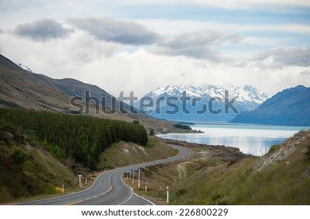 travelling in south island, New Zealand through beautiful road trip via pukaki lake - stock photo