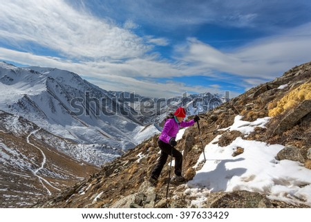 Travelling in the snowy mountains - stock photo