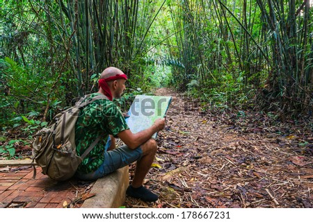 Travelling man sitting in the bamboo forest. Phuket - stock photo