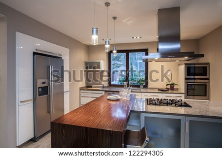 Travertine house - creative solutions for your spacious kitchen - stock photo