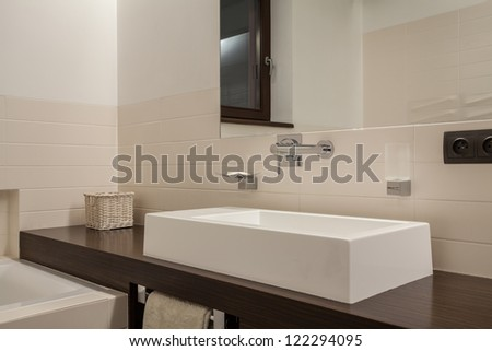 Travertine house - elegant washbasin on wooden shelf