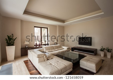 Travertine house: Horizontal view of a living room interior - stock photo
