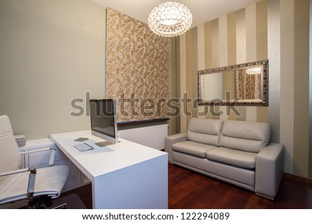Travertine house - horizontal view of comfortable home office - stock photo