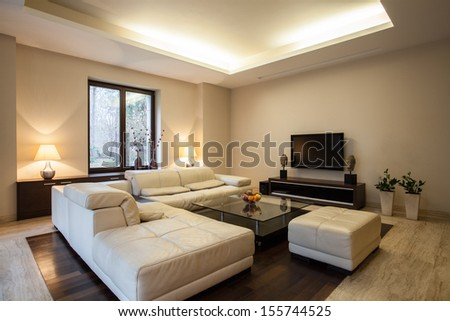 Travertine house: Horizontal view on arranged living room - stock photo