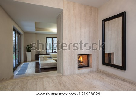 Travertine house: Horizontal view on entrance to living room - stock photo