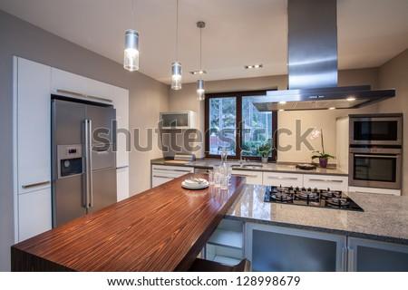 Travertine house- Horizontal view on iluminated kitchen - stock photo