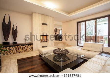 Travertine house: interior of beige living room - stock photo