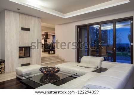 Travertine house - living room and view of dining room - stock photo
