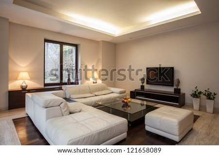 Travertine house: View on bright,unusual living room - stock photo