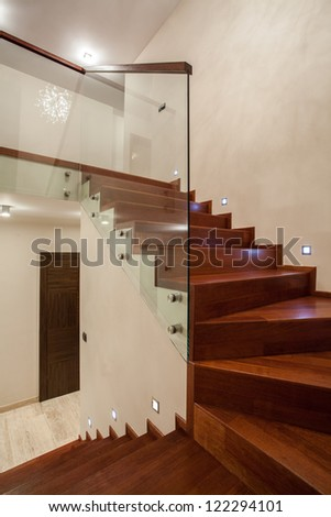 Travertine house - Wooden glass staircase in modern interior - stock photo