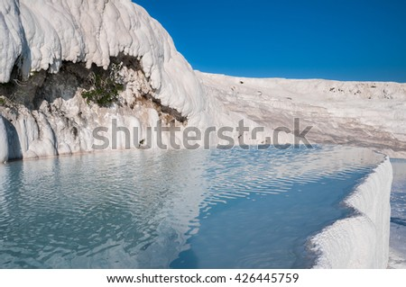 Travertine pools and terraces in Pamukkale (Turkey) - stock photo