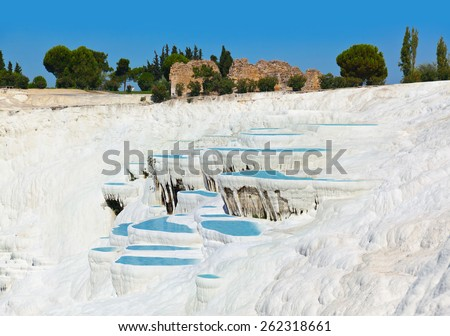 Travertine pools and terraces - Pamukkale Turkey - stock photo