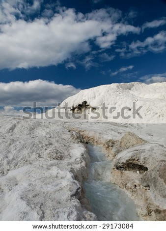Travertine pools and terraces with water, Pamukkale, Hierapolis Turkey - stock photo