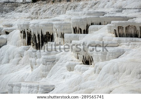 Travertine terrace formations at Pamukkale, Turkey. Travertine -  a sedimentary rock deposited by water from the hot springs. - stock photo