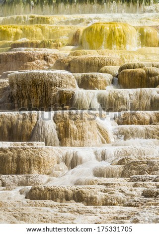 Travertine terraces at Mammoth Hot Springs, Yellowstone National Park, Wyoming, USA - stock photo