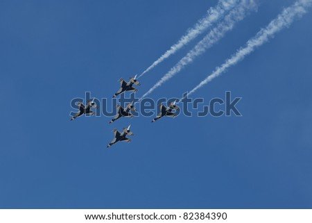 TRAVIS AFB, CA - JULY 30: US Air Force Thunderbirds flying on F-16 showing precision of flying and the highest level of pilot skills during Airshow on July 30, 2011 at  Travis AFB - stock photo