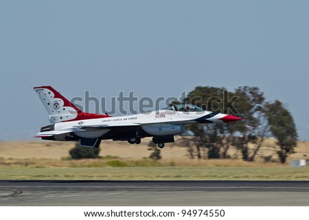 TRAVIS AIR FORCE BASE, CA - JULY 30: USAF Thunderbirds, flying on F-16 Fighting Falcon showing precision of flying and the highest level of pilot skills during  Airshow  on July 30, 2011 at  TAF base - stock photo