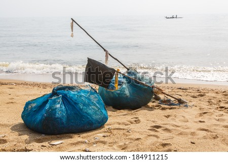 Trawler fishing nets and equipment set out on the beach thailand - stock photo