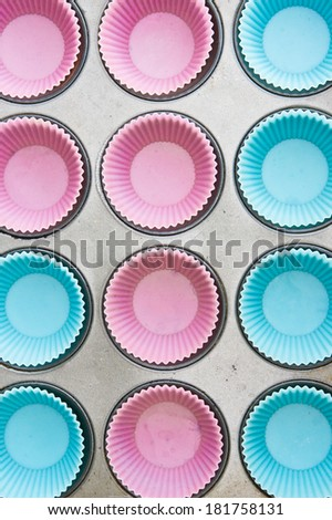 Tray of blue and pink silicon cup cake moulds - stock photo