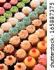 Tray of colorful mini cupcakes - stock photo