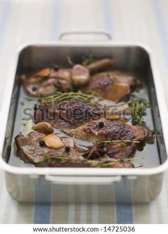 Tray of Confit Duck Legs - stock photo