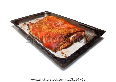 Tray of Cooked belly pork isolated on a white studio background.