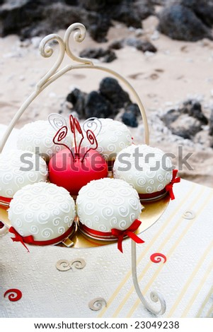 Tray of fancy cakes at a picnic. - stock photo