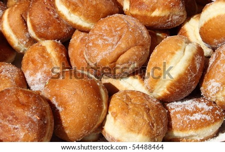 Tray of fresh doughnuts sold in a patisserie - stock photo