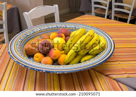 Tray of fresh fruits on the table. - stock photo