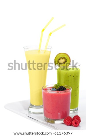Tray of smoothie juice drinks with kiwi, banana and berries on a white background