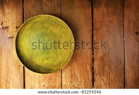 Tray on wooden surface, good as background or something similar. - stock photo